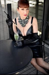 mature mistress wearing latex while sipping champagne