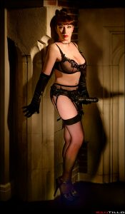 Beautful mistress wearing a strapon with stockings and suspenders
